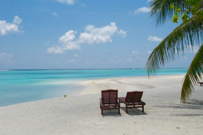 Maldives beach with chairs